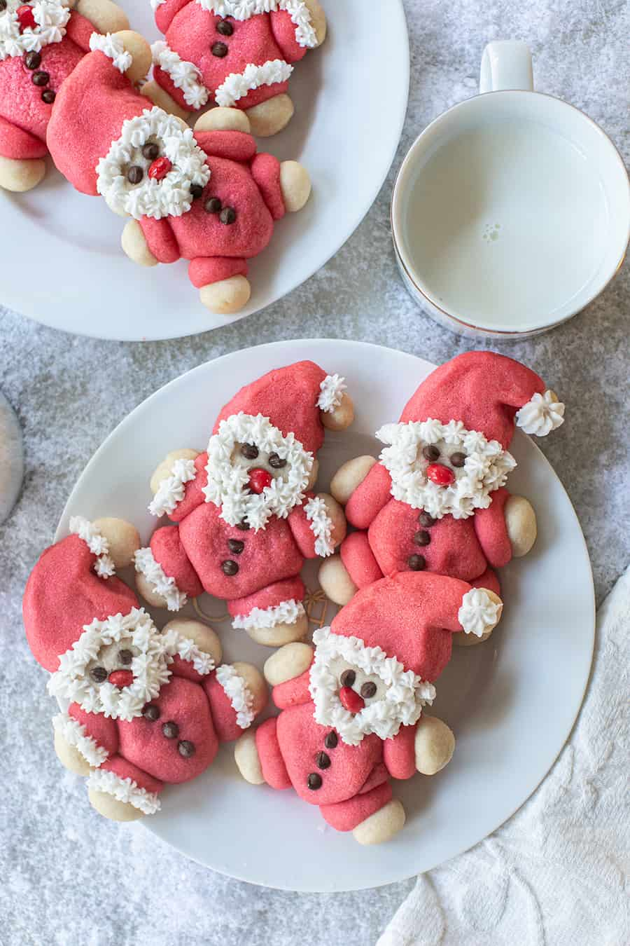 Roly Poly Santa cookies on a white plate