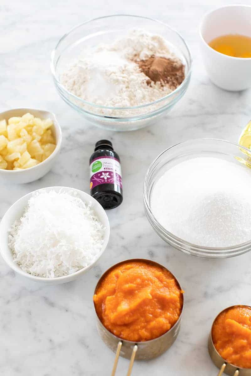 Ingredients on a marble table to make cupcakes.