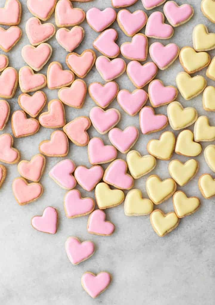 Mini heart shaped sugar cookies with colored frosting