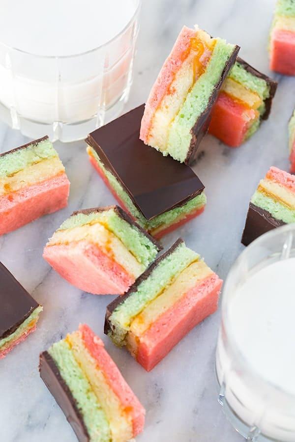 Italian rainbow cookies with a glass of milk