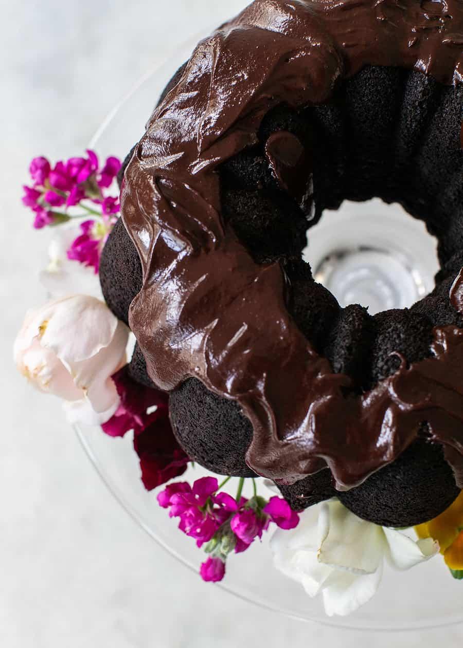 Chocolate bundt cake with a chocolate ganache glaze and flowers