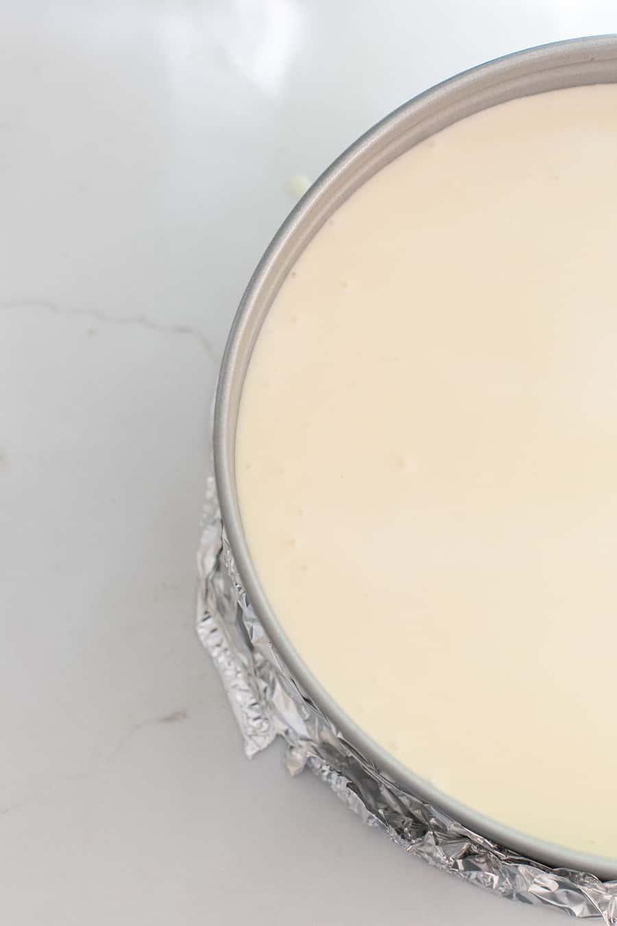 Cheesecake batter in springform pan