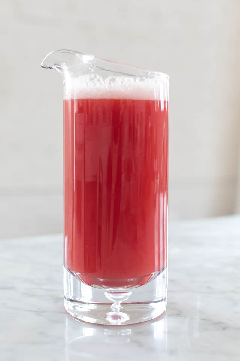 Watermelon juice in a glass pitcher.