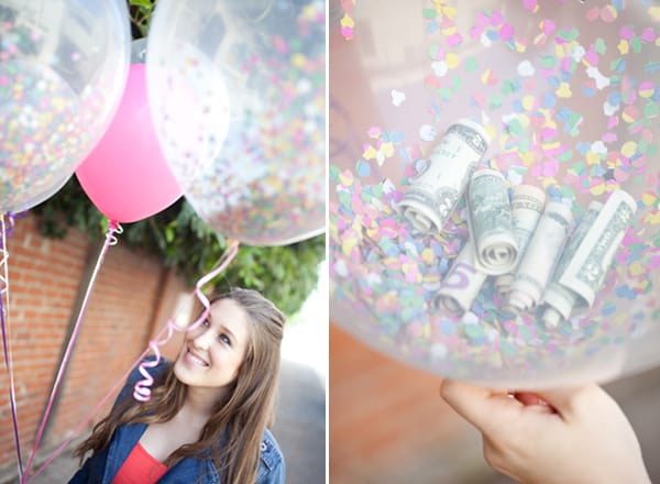 Money inside balloons with confetti.