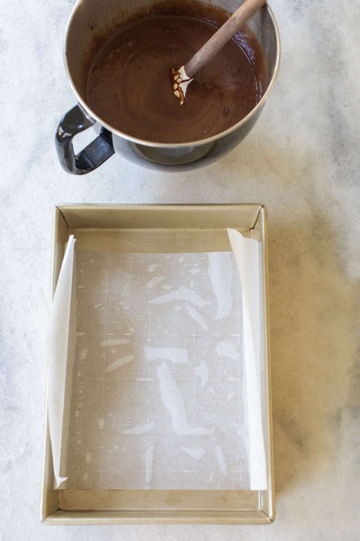 9x13 baking sheet and cake batter in a mixing bowl