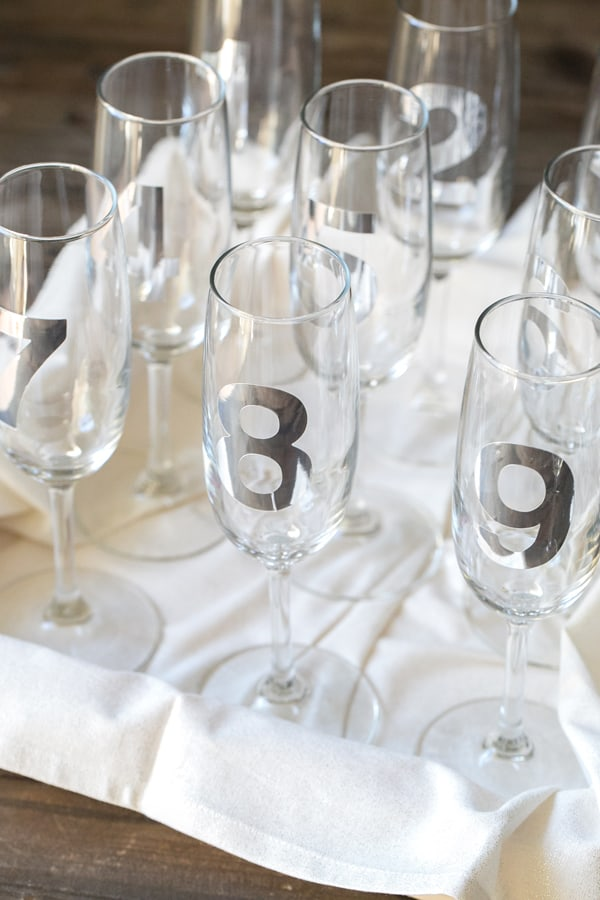 Champagne glasses with number stickers on them for New Years Eve