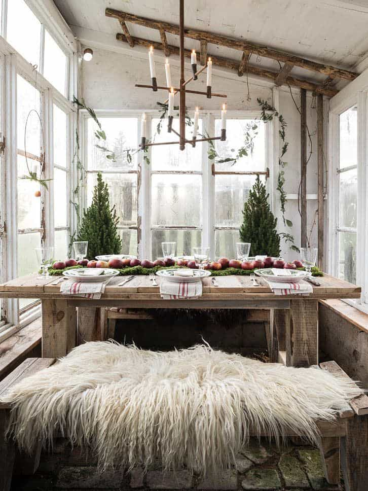Scandinavian Christmas table setting with sheepskin and wooden candle.