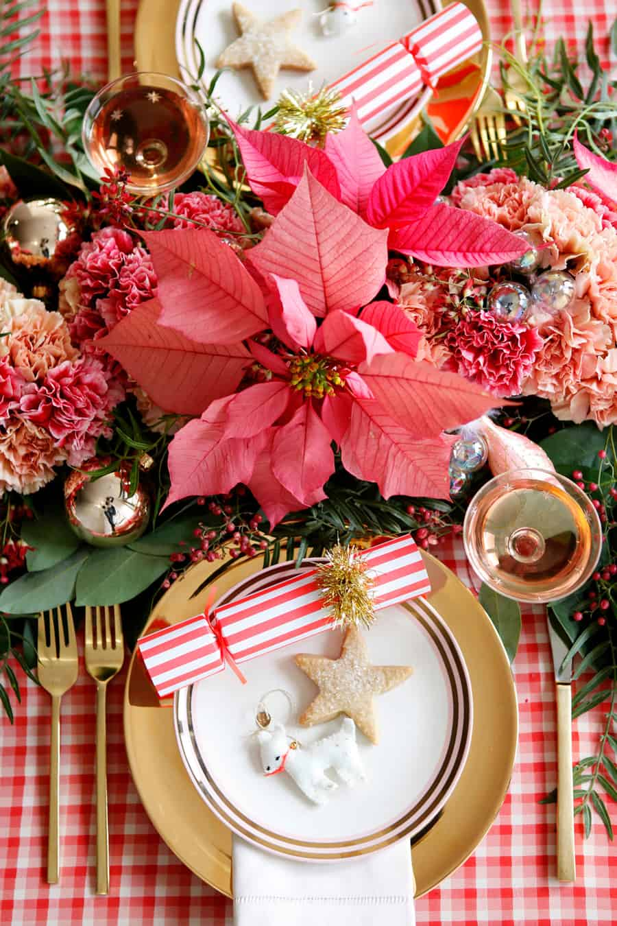 Christmas table setting with plaid table, flowers, cookies and ornaments