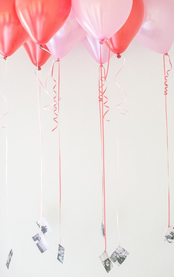 Red and pink balloons with black and white pictures tied to the string.