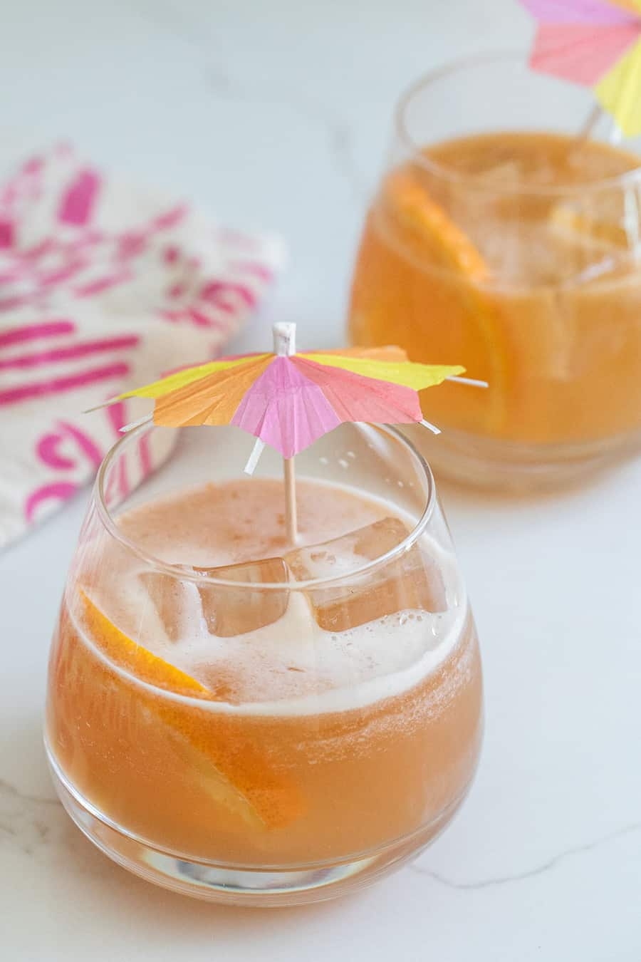 rum punch in a glass with a cocktail umbrella