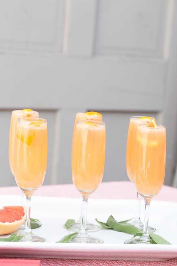 6 grapefruit mimosas on a tray
