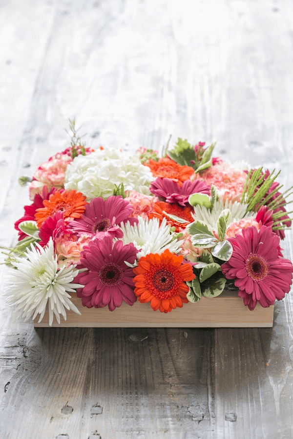 Beautiful flowers in a wooden box