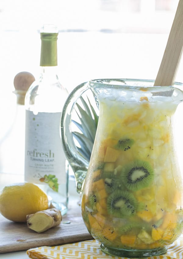 White wine sangria recipe in a pitcher with kiwi, pineapple and mango.