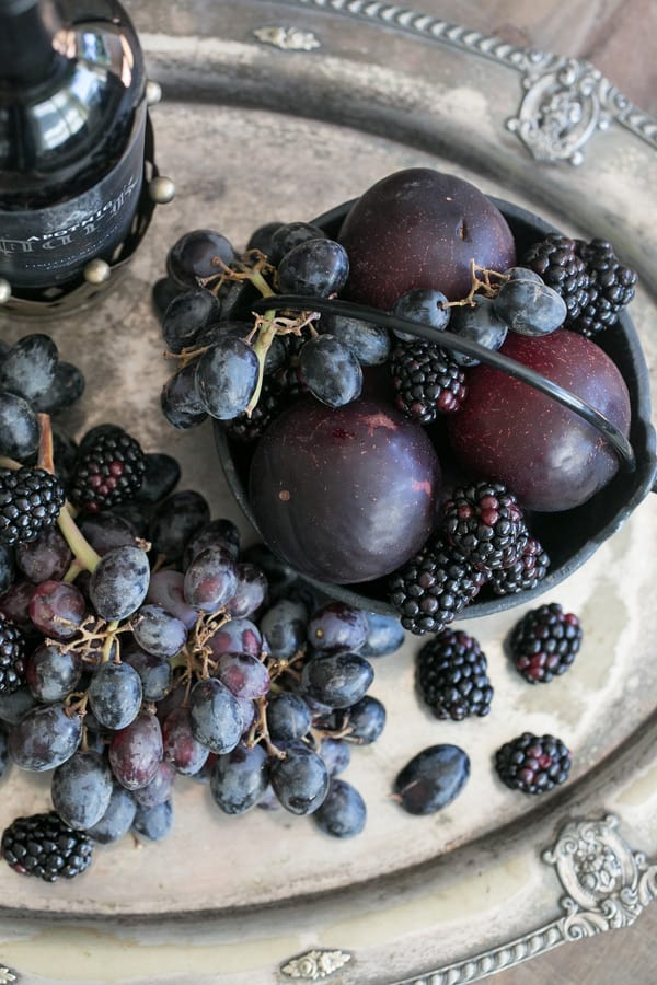 Dark fruit for black sangria, including plums, blackberries, and grapes