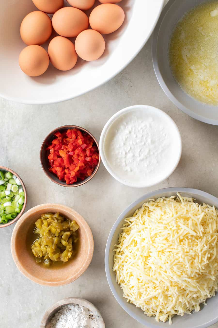 Eggs, cottage cheese, butter, green chilis, pimentos, onions and cheese to make a frittata