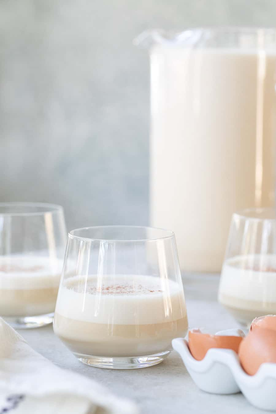 homemade eggnog in a glass with cinnamon