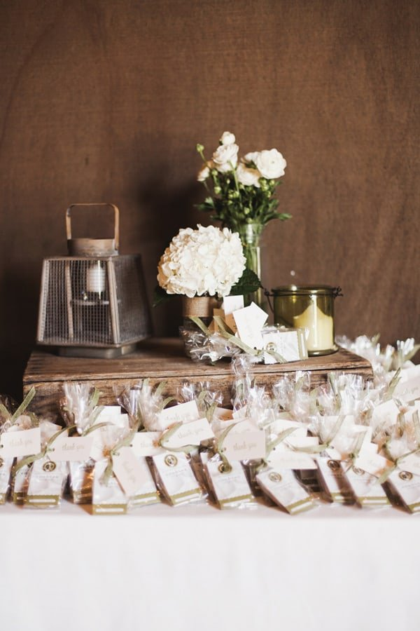 Wedding favors and flowers on the table.