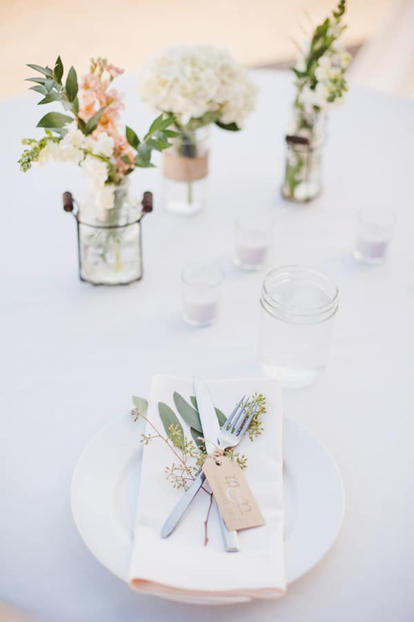 Simple wedding table setting with flowers.