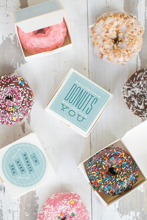 Small white boxes filled with donuts with a charming I'm Donut Valentine's Day printable.