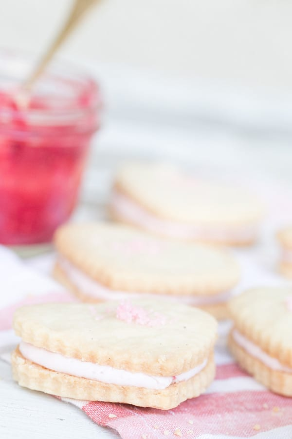 Raspberry Shortbread Cookies with White chocolate raspberry filling and raspberry sea salt.