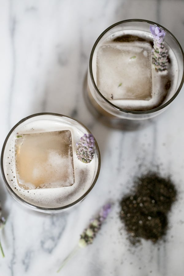 Top down shot of two earl grey tea cocktails garnished with lavender.