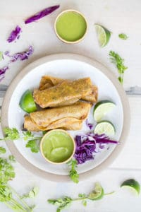 Bean and Cheese Crispy Corn Tacos with Cilantro Lime Sauce