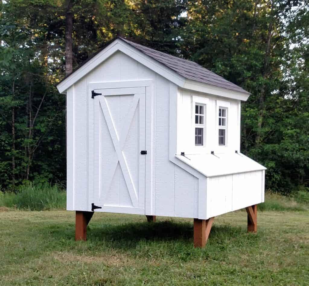 White cottage chicken coop.
