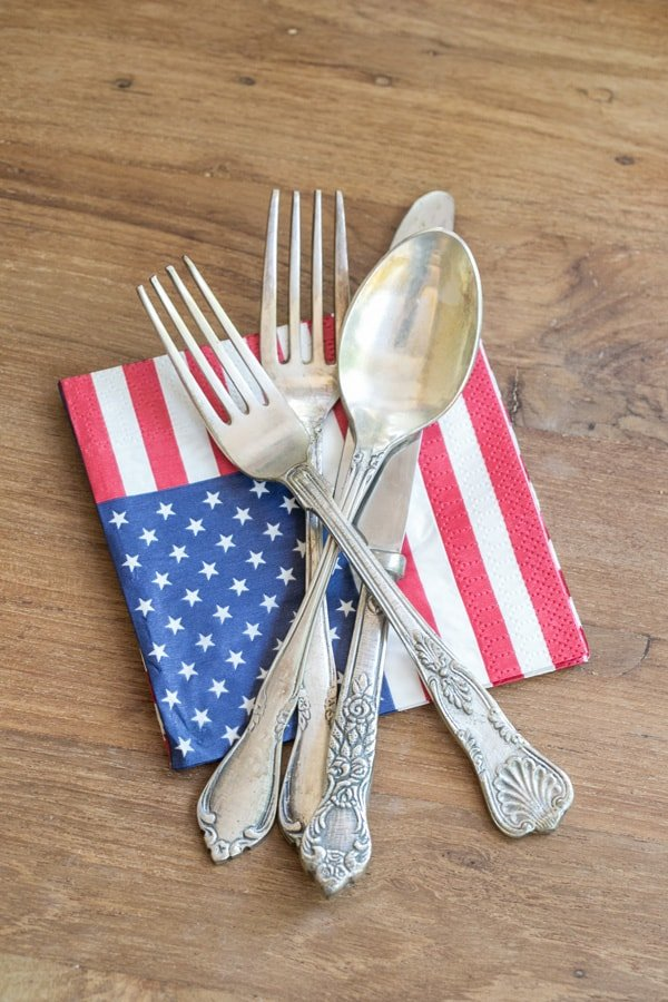 vintage silverware and an American flag napkin