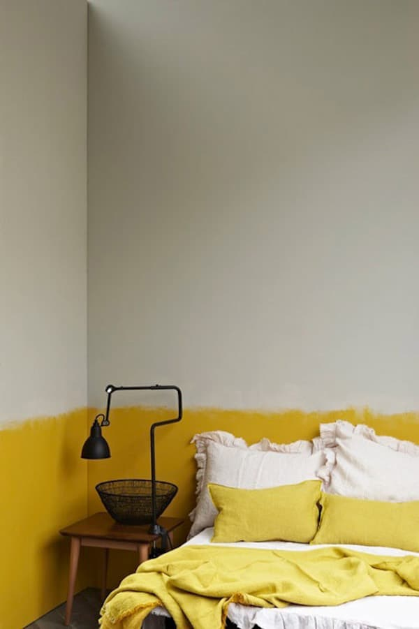Half painted rooms with yellow and white walls