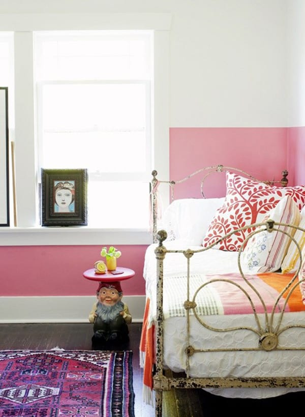 Half painted pink wall in girls room