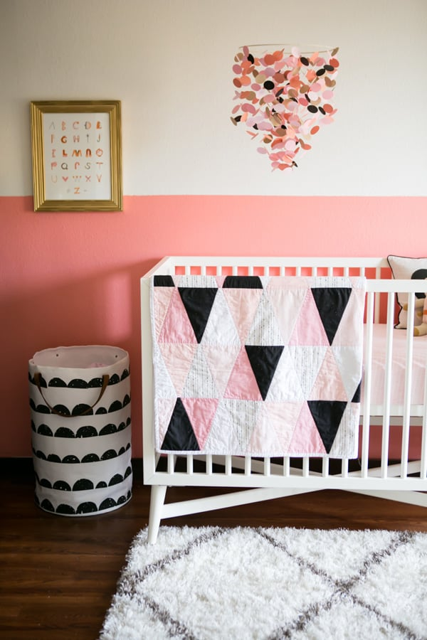 Hand painted baby room with pink and white walls