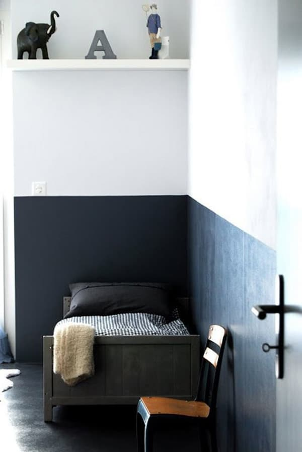 Half painted boys room with black and white walls.
