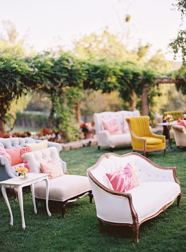 Couches and chairs on a lawn with tables
