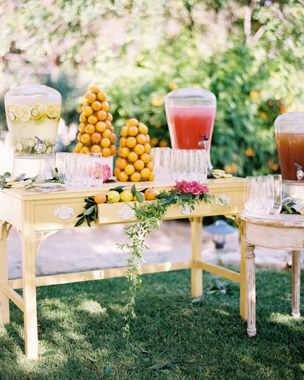 Vintage dresser with lemonade and orange trees at a wedding.