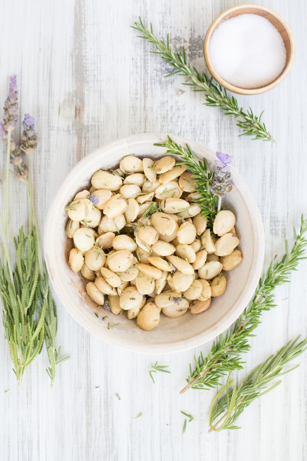 Marcona almonds with lavender and rosemary in a bowl.