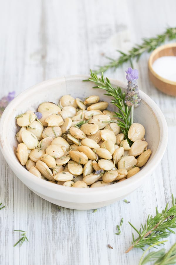 Marcona Almonds in a bowl with lavender and rosemary