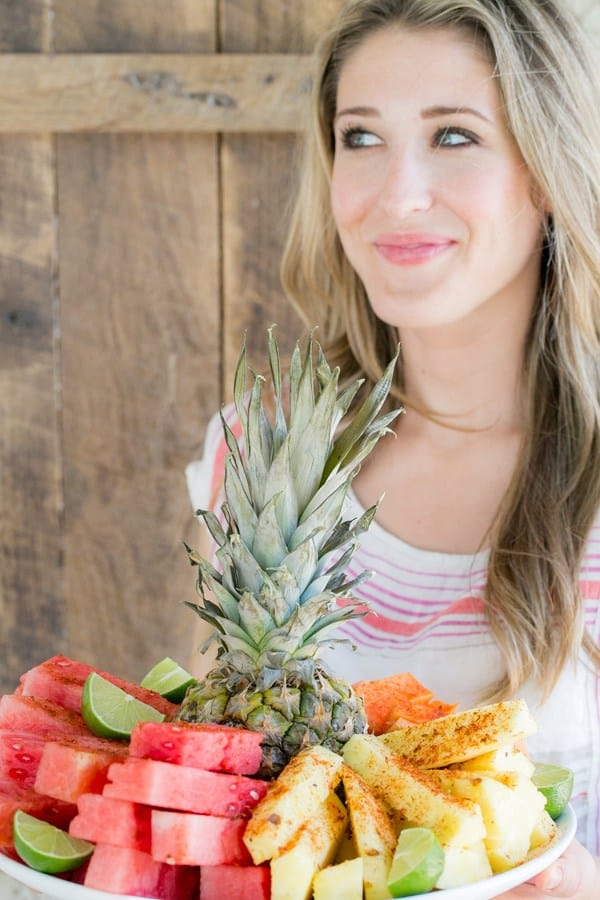 Eden Passante holding a Mexican style fruit plate.