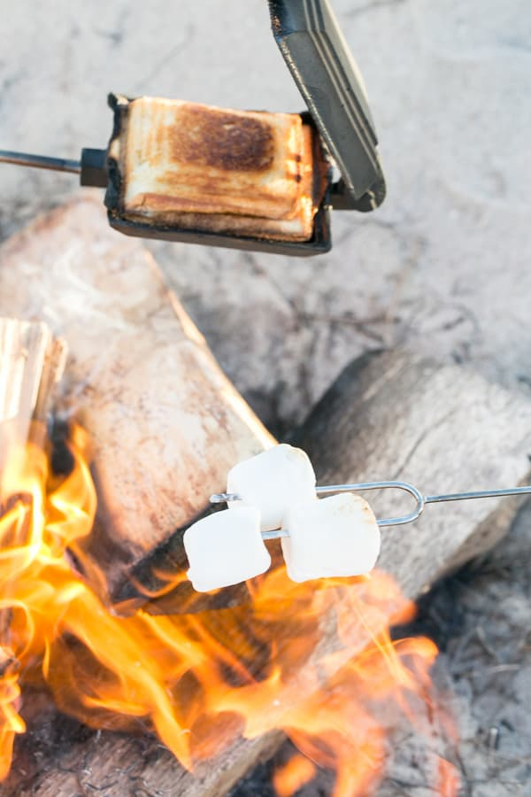 food being cooked on the beach bonfire