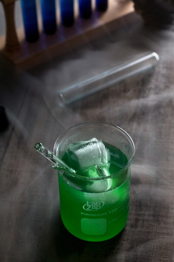 Green cocktail in glass jar.