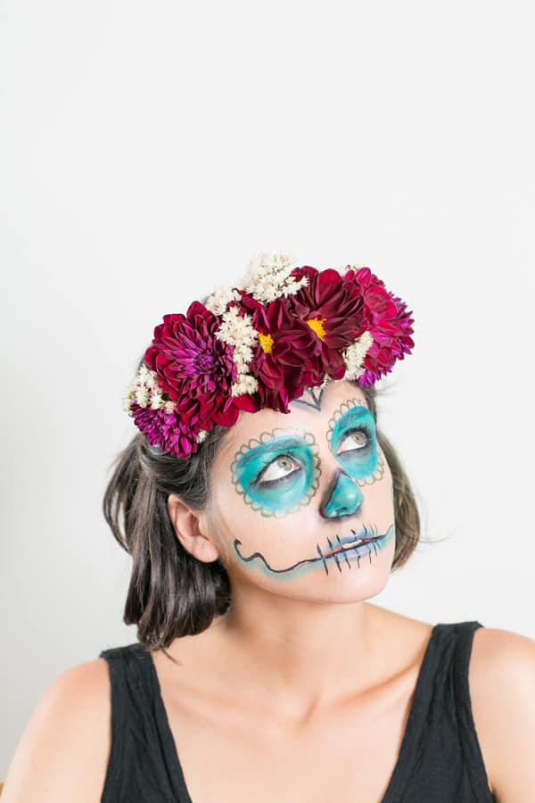 Girl with her face painted as a Dia de los Muertos skull.