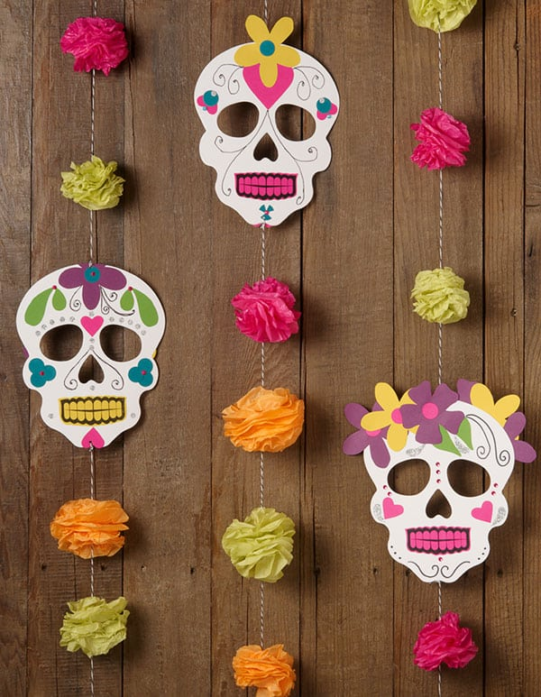 Paper garland with skulls and pom poms.