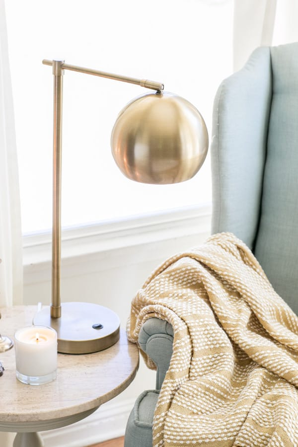 Gold lamp on a table in a cozy ready nook
