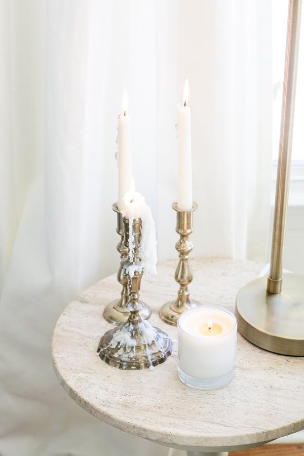 gold candle sticks on a marble table