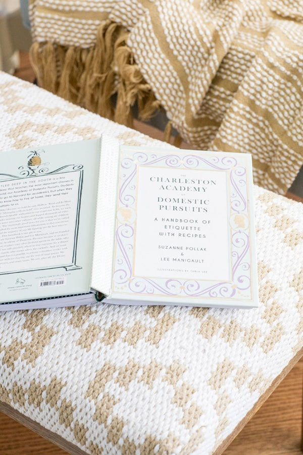 a book on an ottoman