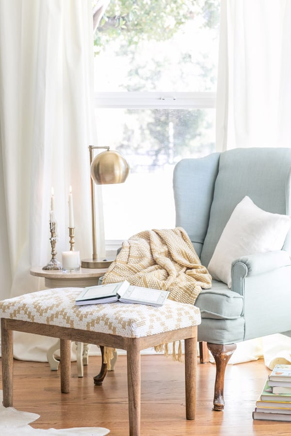 how to make a charming reading nook with a bench, chair and table.