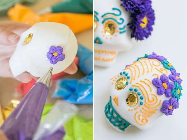 shot of icing flowers being piped on Mexican sugar skulls