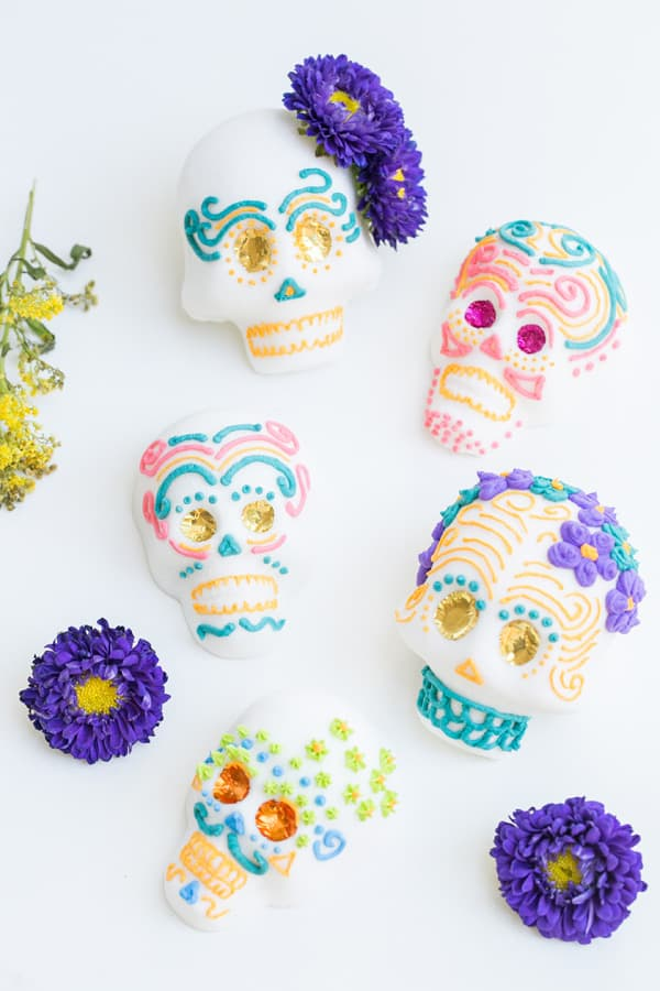 overhead shot of Mexican sugar skulls frosting with colorful frosting