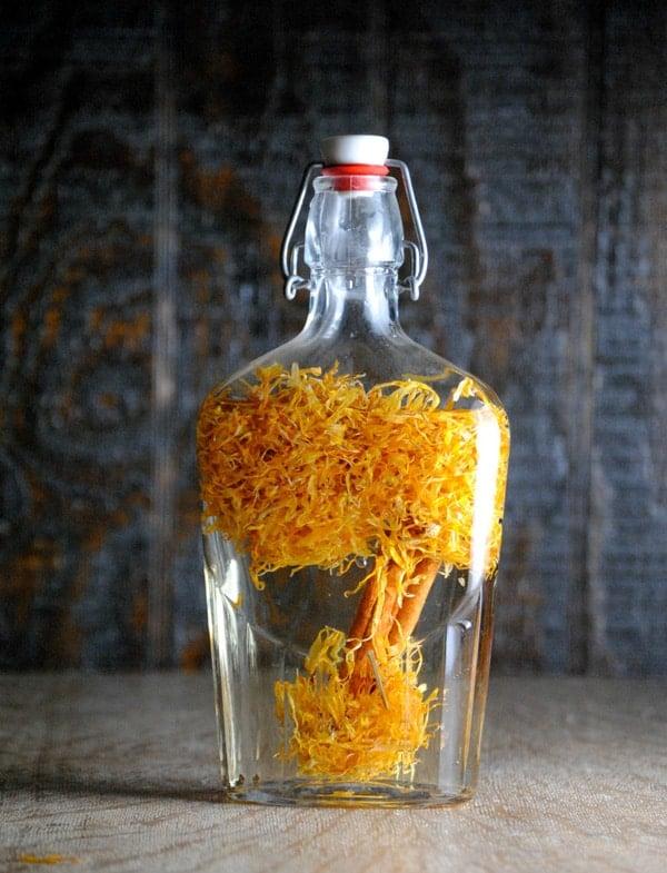 Elderflower tequila in a clear glass bottle.