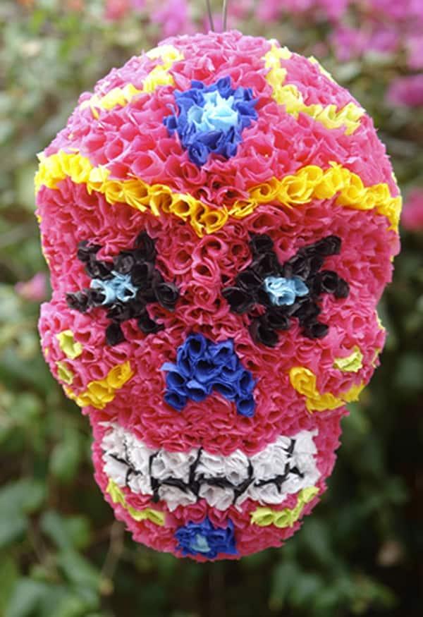 Sugar skull pom pom piñata.
