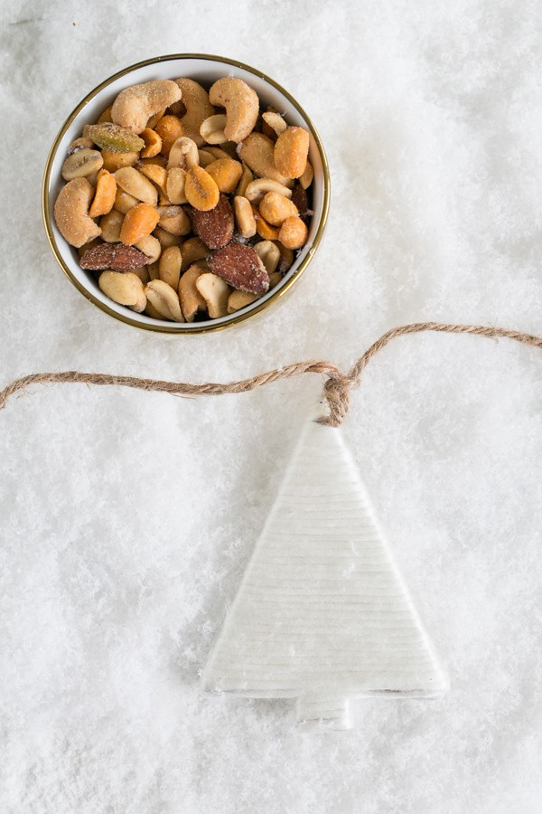 Holiday Christmas tree garland and nuts in a small bowl.